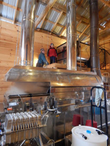Morgan and John checking the concentrate tank above the evaporator.