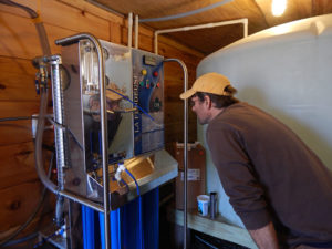 Dan checking the gauges on the reverse osmosis machine.